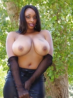 African Vixen Exposes Her Monumental Chocolate Tits And Rubbing Her Piquant Looking Pussy